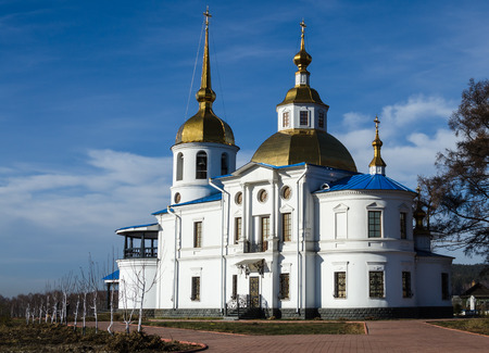 orthodox: white orthodox church with golden dome Stock Photo