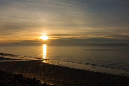 Sunrise over the Bristol Channel and Penarth beach. Stock Photo
