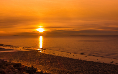 Golden sunrise over the Bristol Channel and Penarth beach. Stock Photo