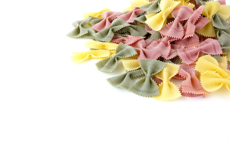 extra large: Heap of extra large multicolored farfalle pasta isolated on a white background.