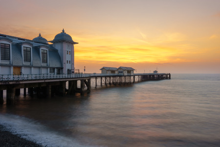 Penarth Pier with pebble beach and the Bristol Channel, Wales, United Kingdom at sunrise. Editorial