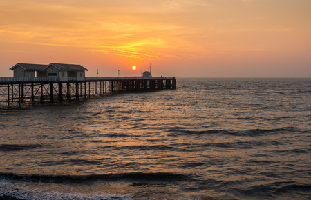 Penarth Pier and the Bristol Channel, Wales, United Kingdom at sunrise.