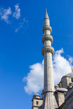belonging: Closeup of a minaret belonging to the New Mosque (Yeni Cami), Eminonu district, in Istanbul, Turkey.