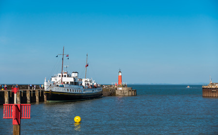 bristol channel: Watchet, United Kingdom - August 15, 2016: Passengers are walking to board the MV Balmoral ship to continue their Bristol Channel cruise after a one hour stop in Watchet harbour.