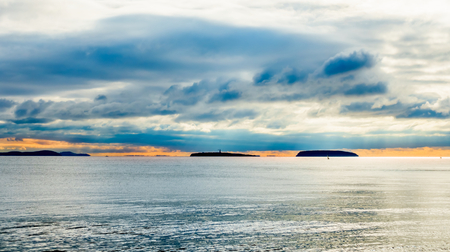 Steep Holm and Flat Holm Islands in the Bristol Channel at sunset during typical British autumn weather.
