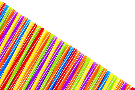 diagonal stripes: Diagonally arranged large colorful drinking straws on white background with lots of copy space.