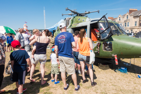Weston-super-Mare, United Kingdom -  June 17, 2017: People are queuing  to have a look inside the helicopter at the public and free Airshow in Weston-super-Mare 2017 Editorial