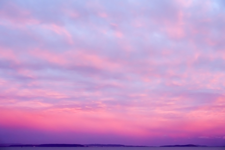 Dramatic sunset sky in deep purple , pink and magenta colors.
