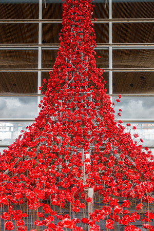 Cardiff, Wales, United Kingdom - September 15, 2017: Weeping Window, a cascade of several thousand handmade Poppies pouring from a window of the Welsh Assembly Building in Cardiff Bay, Cardiff.