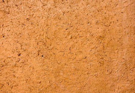 Moroccan mud wall in ochre color as background.