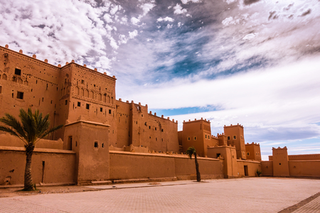 Closeup of the Taourirt Kasbah, a Unesco world heritage site, in Quarzazate, Morocco, North Africa, against the backdrop of a dramatic sky.