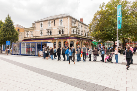 Cardiff, United Kingdom -  September 07, 2017: People are queuing for a free sandwich provided by Lurpark in Cardiff city centre. Editorial
