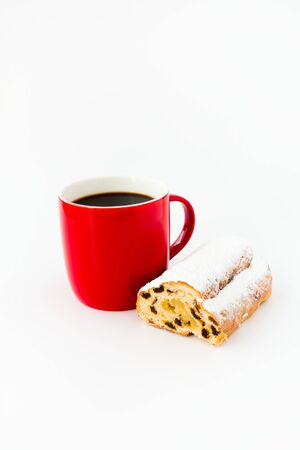 Mini Stollen and red mug filled with black coffee isolated on white.