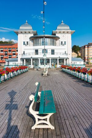 Penarth Pier and Pavilion and Penarth Pier in summer 2019 with beautiful flowers hanging on the victorian railings. Government owned. Not private property.