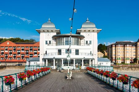 Penarth Pier Pavilion and Penarth Pier in summer 2019 with beautiful flowers hanging on the victorian railings. Government owned. Not private property.