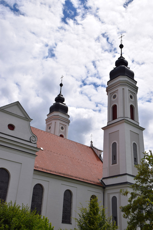 IRSEE, BY, GERMANY - JUNE 26, 2018: Irsee monastery with two steeples, Imperial Abbey of irsee in front of cloudy sky in june