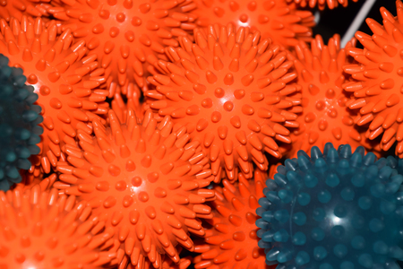 massage or fascia balls without people, orange and blue prickly or therapy balls with flashlight reflections on them