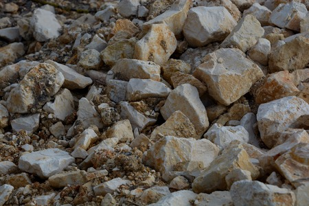 rough pulverized stones on a construction site, broken rock in a heap in different sizes on a construction site