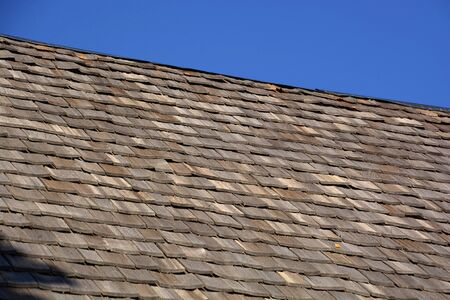wood shingles on a roof top of an old hut in bavaria, wood shingle roof renovated Banco de Imagens