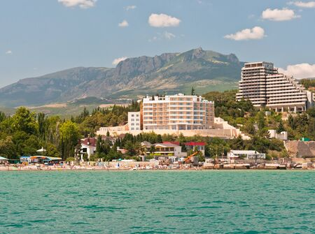 The southern coast of the Crimea  View from the sea on Barton Park hotel and the mountain Kastel Ukraine Stock Photo - 16851913