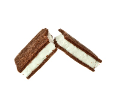 Broken chocolate biscuits on a white background  photo
