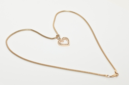 Heart made with gold chain isolated on white