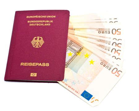 German passport with Euro banknotes Stock Photo