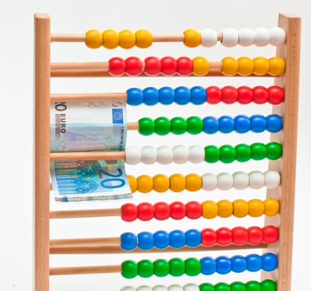Close view of an abacus with colored beads end Euro