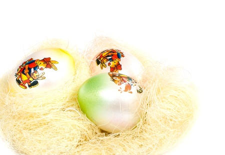 decorated easter eggsn a nest- isolated on white  Stock Photo