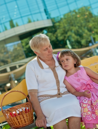 Little girl  on the bench with Grandma Ukraine,Vinnytsia  photo