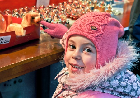 little girl on a Christmas market photo