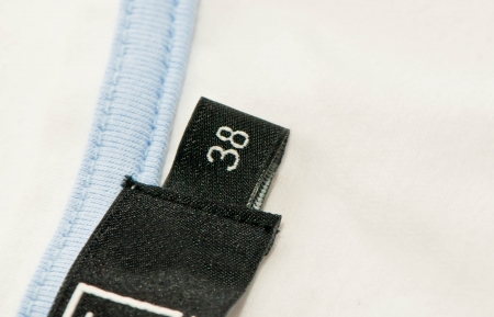 Clothing label with the size 38or Extra Large  Macro photography with extreme detail and shallow depth of field