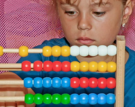 Little Girl with abacus  Stock Photo