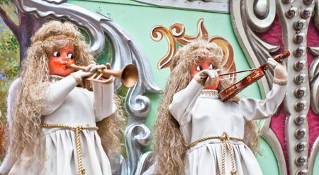 Two  christmas angel figurines as musicians