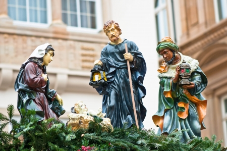Christmas nativity scene with three Wise Men presenting gifts to baby Jesus, Mary   Joseph  Christmas market in Germany   photo