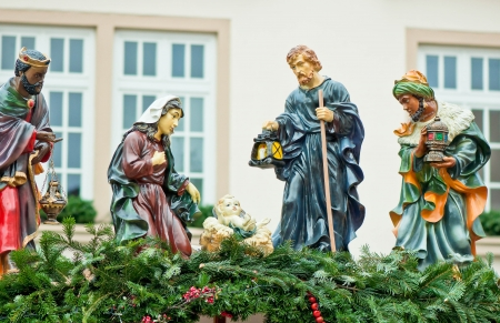 Christmas nativity scene with three Wise Men presenting gifts to baby Jesus, Mary   Joseph  Christmas market in Germany