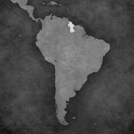 guyanese: Guyana on the map of South America. The map is in vintage black and white style. The map has soft grunge and retro old paper atmosphere. Stock Photo