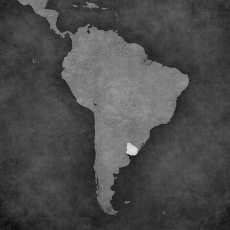 Uruguay on the map of South America. The map is in vintage black and white style. The map has soft grunge and retro old paper atmosphere.