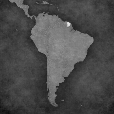French Guiana on the map of South America. The map is in vintage black and white style. The map has soft grunge and retro old paper atmosphere.
