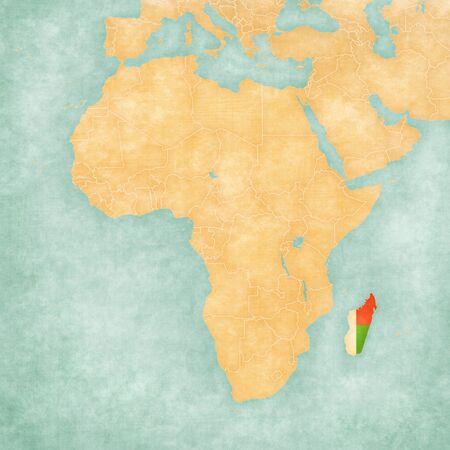 Madagascar (bandera de Madagascar) en el mapa de África. El mapa está en grunge suave y estilo de época, como la pintura de acuarela sobre papel viejo.