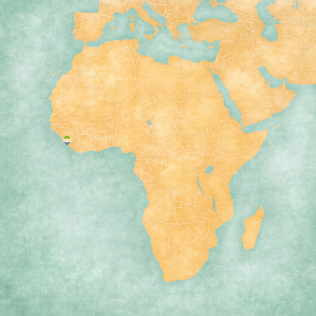 ocher: Sierra Leone (Sierra Leonean flag) on the map of Africa. The map is in soft grunge and vintage style, like watercolor painting on old paper. Stock Photo