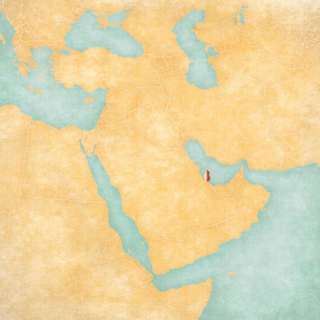 middle east map: Qatar (Qatari flag) on the map of Middle East (Western Asia) in soft grunge and vintage style, like old paper with watercolor painting. Stock Photo