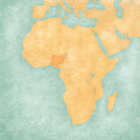 Nigeria on the map of Africa in soft grunge and vintage style, like old paper with watercolor painting. Stock Photo