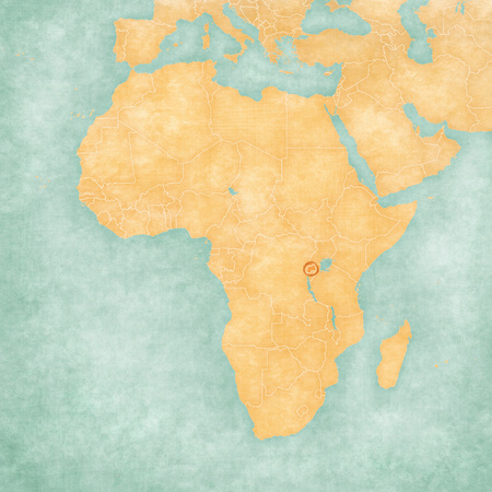 Rwanda on the map of Africa in soft grunge and vintage style, like old paper with watercolor painting.