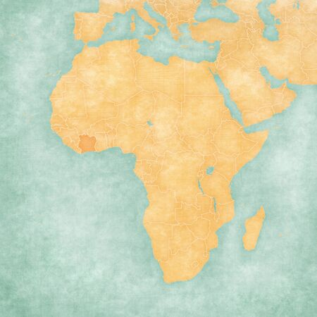Cote dIvoire (Ivory Coast) on the map of Africa in soft grunge and vintage style, like old paper with watercolor painting. Stock Photo