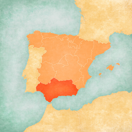 Andalusia (Spain) on the map of Iberian Peninsula in soft grunge and vintage style on old paper.