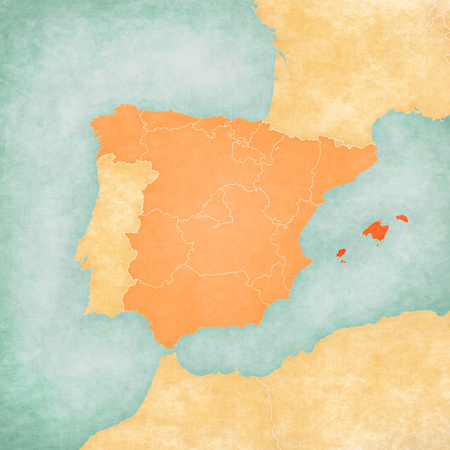 Balearic Islands (Spain) on the map of Iberian Peninsula in soft grunge and vintage style on old paper.