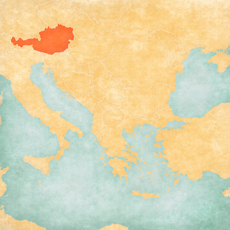 Austria on the map of Balkans in soft grunge and vintage style, like old paper with watercolor painting.