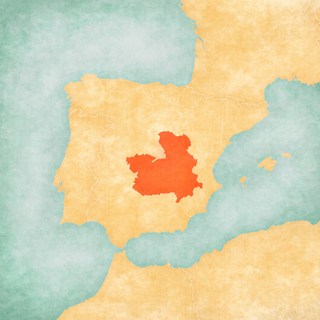Castilla-La Mancha on the map of Iberian Peninsula in soft grunge and vintage style on old paper.