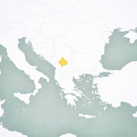 Kosovo on the map of Balkans with softly striped vintage background. Imagens